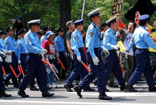 with strong police escort