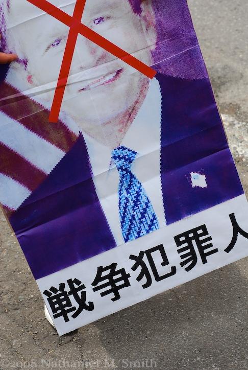 "protest placard-- ""war criminal"""