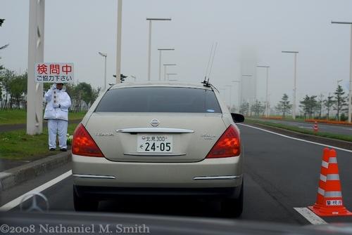following the japanese FBI (NPA) agents' car through a checkpoint
